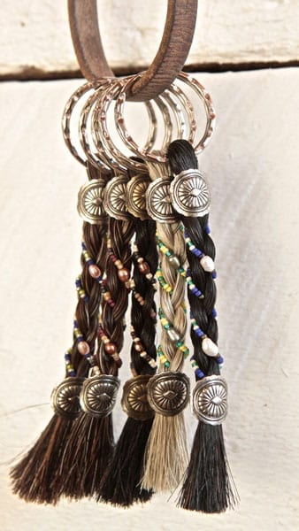 beaded horse hair keychains in various colors and beading